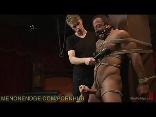Muscle bound hunk tied up and teased