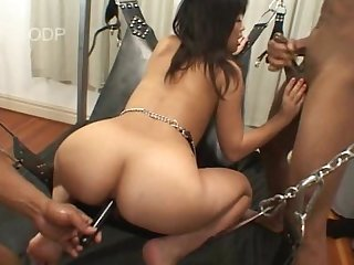 Japanese bitch gets her ass spread then fucked by 2 black dicks