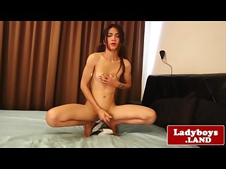 Tgirl spreads buttcheeks before masturbating