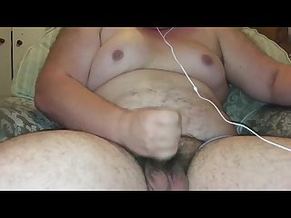 Hairy fat young guy jerks his uncut cock till cum