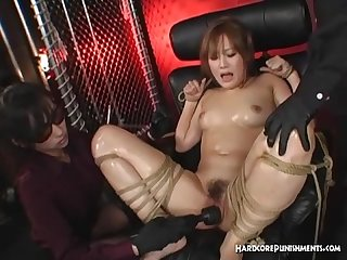 Gorgeous asian girl bound with rope and finger fucked til she squirts