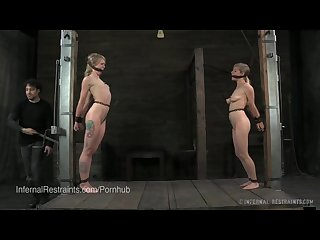Two blondes bound with nipple clamps in predicament