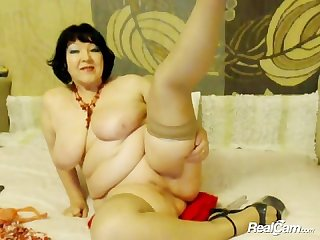 Old granny with huge tits fucks dildo