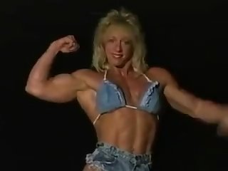 Female bodybuilder posing and smoking