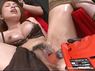 Oriental girl gets oiled up and tied with rope before intense sex toy fuck
