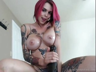 Tattoo girl playing on webcam