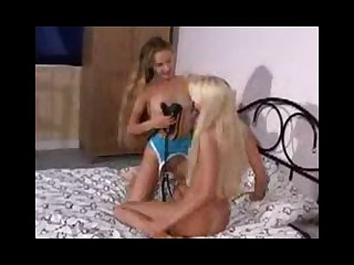 Lesbian blondes prepare for some strap on sex