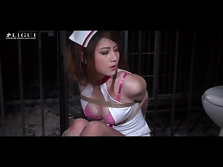 Gorgeous chinese nurse in bondage