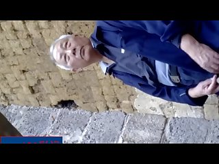Chinese oldman pissing outside