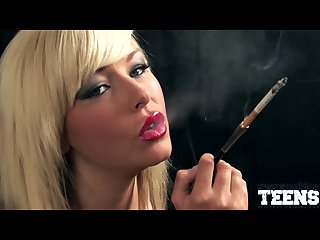 Morgan lees smokes with a cigarette holder