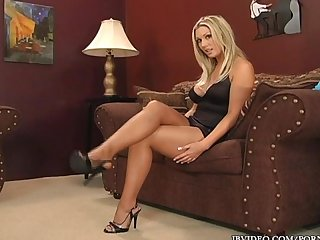 Hot blonde with big tits and big ass shows of her pantyhose