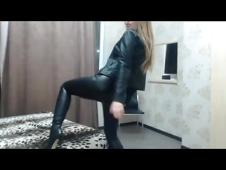 Cute sexy cam girl in leather jacket and leggings