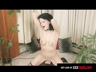 Brunette rides a sybian