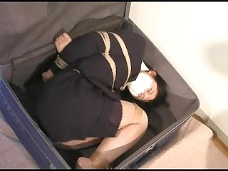Japanese ol bound gagged hogtied and stuffed in a suitcase