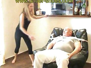 Hot blond girl melts his face with her bare feet real kicks
