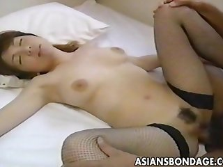 Tender japanese cutie moans while her hairy muff is drilled