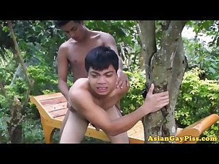 Pissing asian twink outdoor barebacks buddy