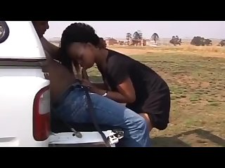 Ebony couple fucking outdoors at back of the truck