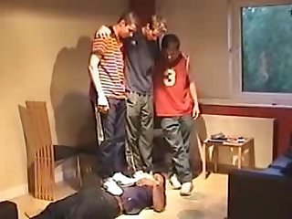 A group of straight teens trample and laugh at their faggot buddy