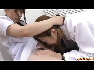 Asian doctor and nurse licking and fingering each other hairy pussies on th