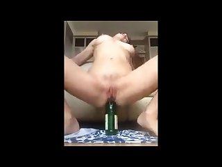 Girl fucks herself by bottle