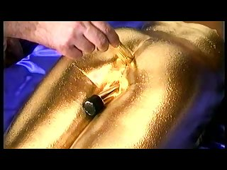 Gold paint and dildo
