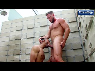 Interracial gay sex in an outdoor shower