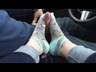 Amazing toejob in car with socks and cumshot on socked feet