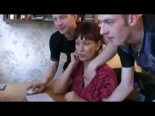 Russian boys teaching mom how to use the computer