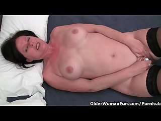 Curvy mature mom in stockings is toying her hairy pussy