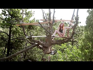 Redhead squirts in a public tree house freckledred