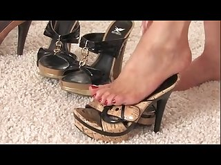 Beautiful milf showing off her sexy shoe collection and her foot fetish