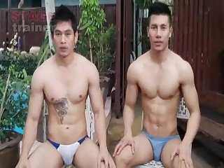 Two cute asian guys flip floping