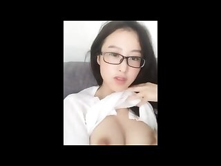 Chinese cam model masturbates wearing glasses