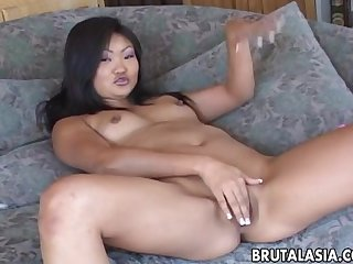 Suave asian hottie moans while riding on a large cock