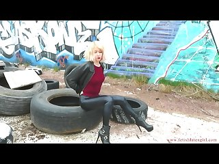 German skinny blonde walks in leather pants and high heels