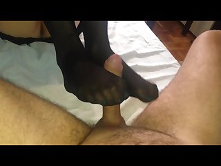 Amateur girlfriend make footjob in black stocking
