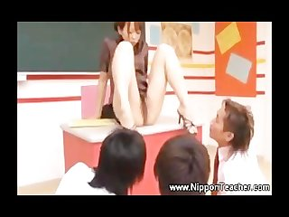 Asian teacher gives upskirt view