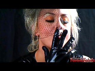 Michelle smoking 120s in sexy leather gloves dress
