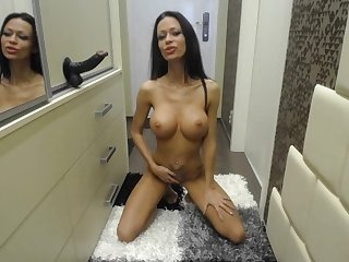 Miamaxxx is having fun with a black dildo