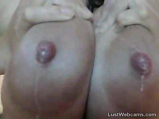 Busty latina milks her huge tits on webcam