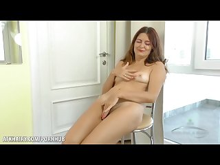 Helen Volga rubs her hairy pussy to climax