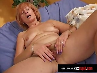 Redheaded grannny plays with her dildo