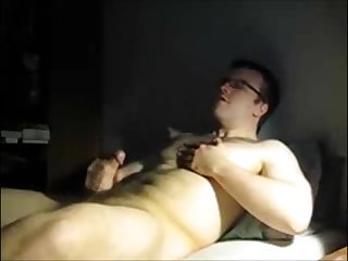 Hairy cub jerks off in bed cums