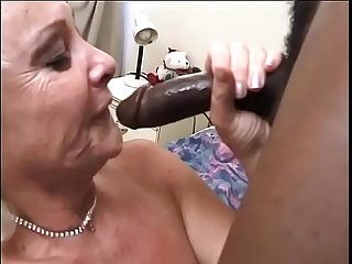 Mature blonde lady Anastasia Sands warms up her her bushy twat waiting for big black dong of her..