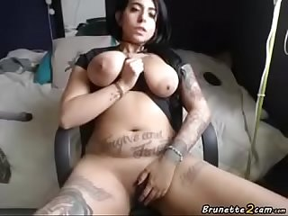 Tattooed Brunette masturbating on webcam