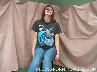 Petite nerdy girl peeing and spreading