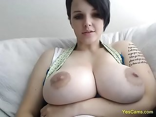 Hot short hair brunette with huge tits masturbates live at YesCams.com