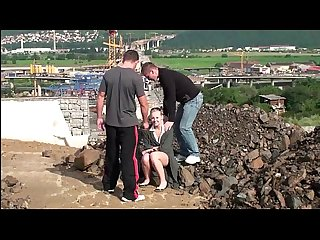 Young cute blonde teen girl PUBLIC threesome at a construction site