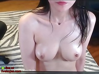 Korean model oils her nice boobs